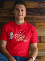 man-wearing-a-tshirt-mockup-while-sitting-against-a-wooden-wall-a17849-(1)-min