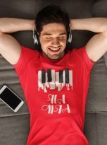 t-shirt-mockup-of-a-man-listening-music-laid-on-his-couch-34521-r-el2-min